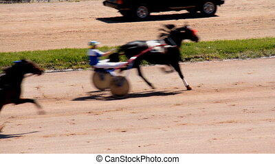 Horse riding on the racetrack