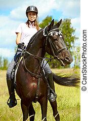 Horse riding - Image of happy female sitting on purebred...