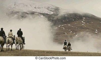 Horse trek on a misty morning.