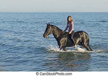 horse woman in the sea