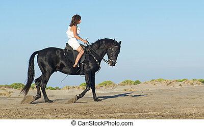 horse woman on the beach