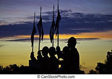 Horseback police officers at sunset