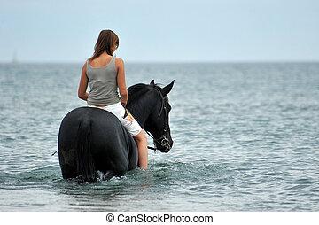 horseback riding in the sea