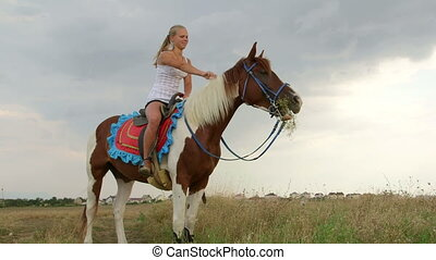 Horseback riding vacations young girl smiling in saddle long...