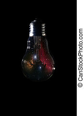 Horsehead Nebula inside of light bulb on dark background