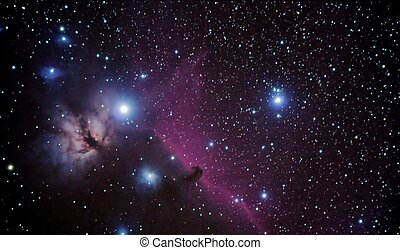 real astronomic picture taken using telescope of famous horsehead and flaming nebulaes, in orion constellation