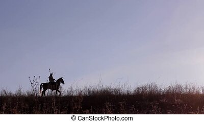 Horseman - Rider on horse on beautiful background of sunset