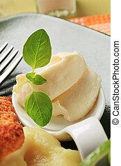 Horseradish cream spread on a porcelain spoon