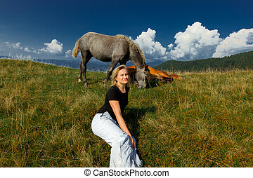 horses graze high in the mountains