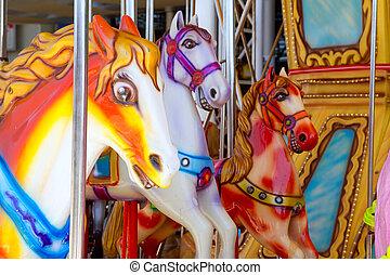 horses in merry go round fairground