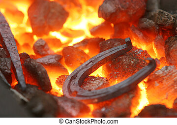 Horseshoe in a forge - Closeup of a horseshoe in a forge