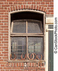 Horseshoes in front of a window