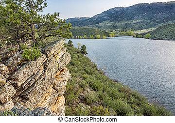 Horsetooth Reservoir at springtime - sandstone cliff and ...