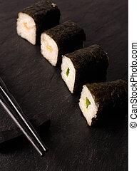 Hoso Maki sushi - Hoso Maki Sushi on a dark slate plate