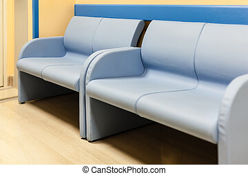 Hospital bench - blue lounge benchs in an hospital corridor