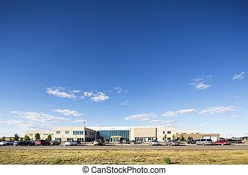 Hospital Building Against Blue Sky - Wide angle shot of...