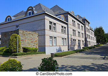 Hospital building in small city Banneux, Belgium. Smal place...