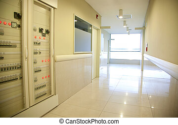 Hospital Hallway - A hospital hallway with an electronics...