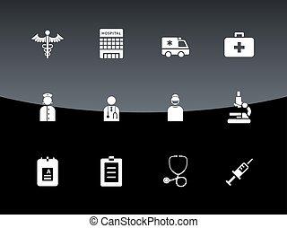 Hospital icons on black background.