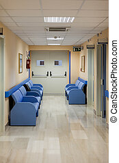 Hospital lounge - blue lounge benchs in an hospital corridor