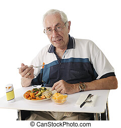 Hospital Meal - An elderly man eating a hospital meal in his...