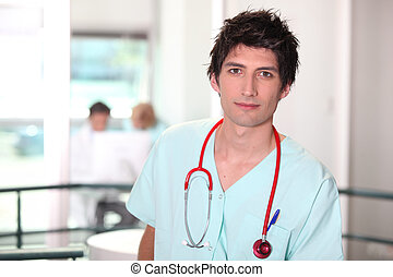 Hospital medic in scrubs with stethoscope
