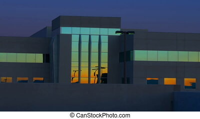 High definition time lapse of the sunrise reflecting off the windows of a hospital in las vegas.