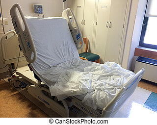 Hospital room bed empty raised up