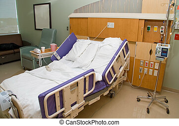Hospital Room - A medical patient\\\'s bed in a hospital.