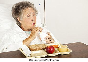 Hospital Senior Has Lunch - Senior woman in the hospital,...