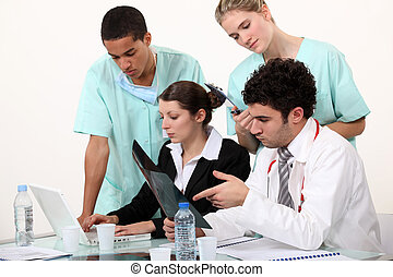 hospital staff analyzing a case