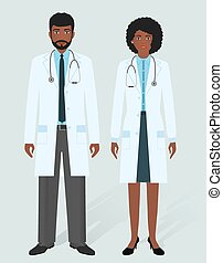 Hospital staff concept. Man and woman african american doctors in medical gowns. Medical people.