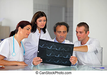 Hospital staff looking at an x-ray