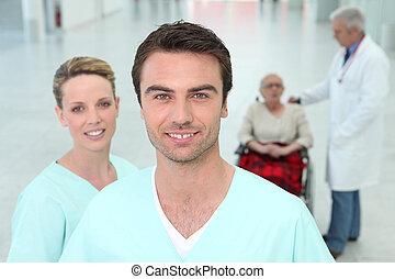Hospital staff with elderly patient