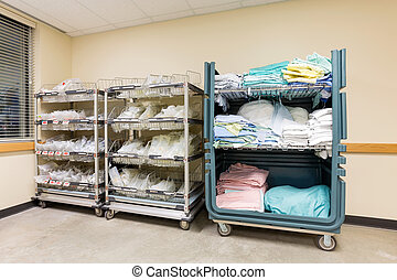 Hospital Supplies Arranged In Trolleys - Large group of...