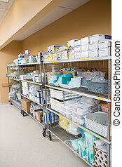Hospital Supplies Arranged On Trollies - Large group of...