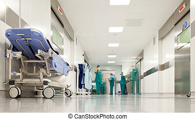 Hospital surgery corridor - Blurred figures of people with...