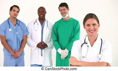 Hospital team posing together against white background