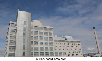 Hospital w/ timelapse clouds. Wide. - Hospital with blue sky...