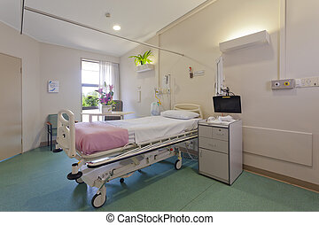 Hospital ward with bed and medical equipment