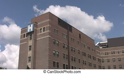 Hospital with timelapse clouds. - A hospital with blue sky...