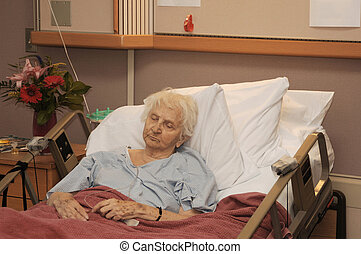 Elderly woman in hospice bed