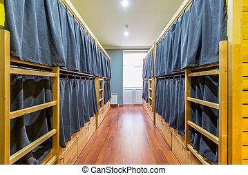 Hostel dormitory beds arranged in room