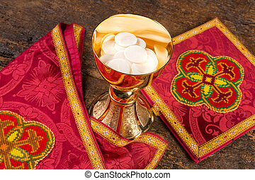 Hosts or wafers in chalice for communion - Communion scene...