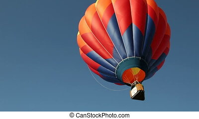 Hot Air Ballon Flies Skyward - Hot air balloon flies skyward...