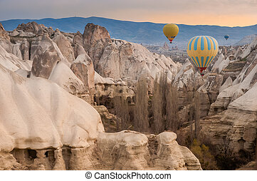 Hot air ballon flying over the landscape of Cappadocia - Fly...