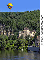 Hot air balloon above the village of La Roque-Gageac - Dordogne - France