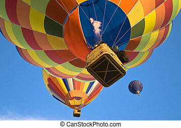 balloonist actioning the burner to reach the hot air balloon above