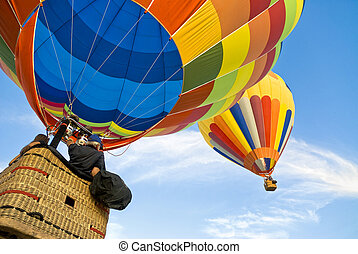 hot air balloon and balloonists - Balloonists running after ...