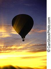 Hot air balloon at sunset.